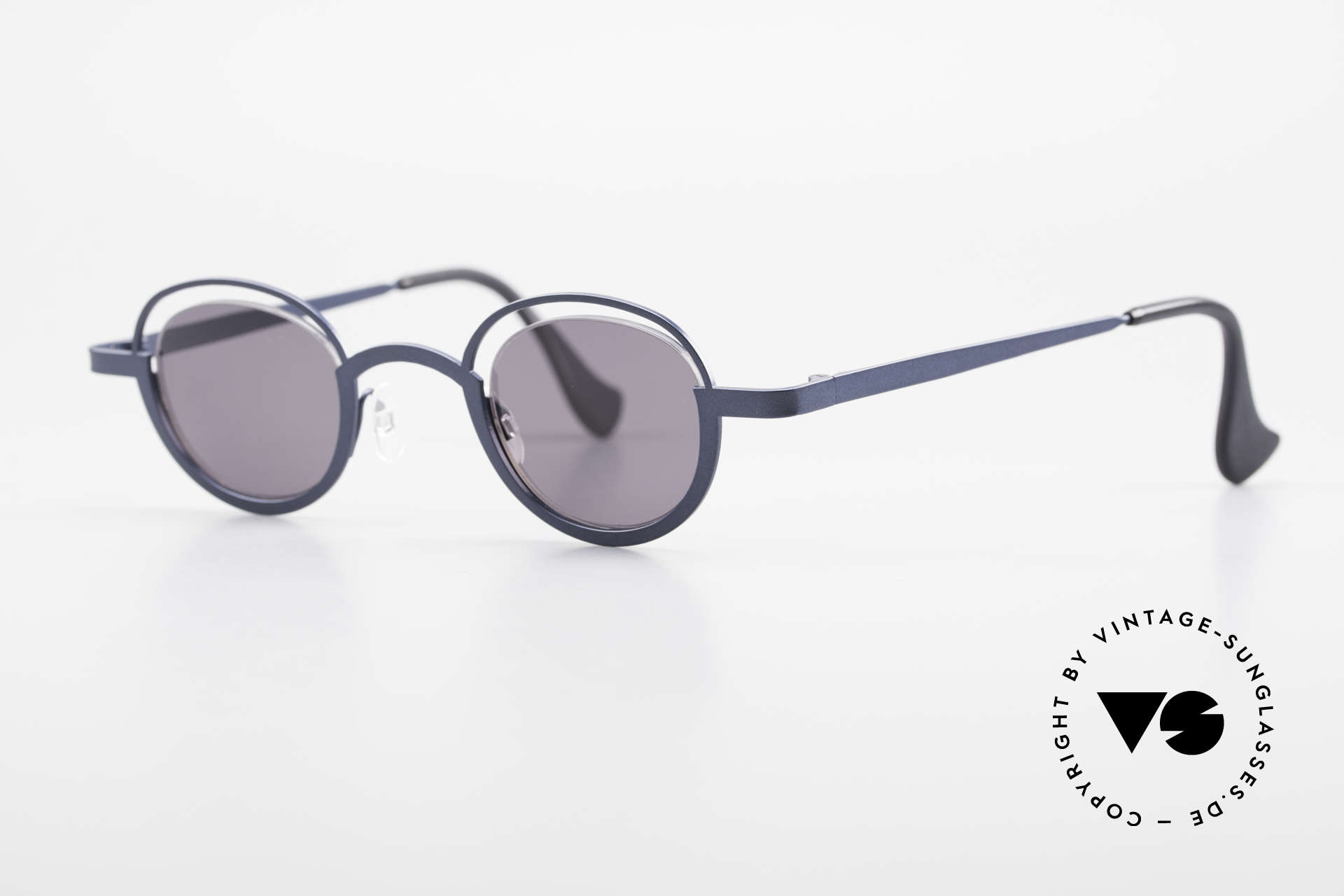 Theo Belgium Dozy Slim Verrückte 90er Sonnenbrille, Gläser werden u.a. durch einen Nylor-Faden gehalten, Passend für Herren und Damen